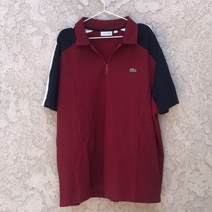 A Burgundy, navy, and white polo Lacoste shirt
